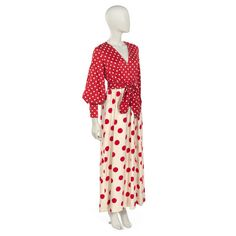 """Dress of cotton twill; fitted bodice of red cotton twill with white polka  dots; """"V"""" neckline; long bishop sleeves. Skirt of white cotton woven with a  paisl..."""