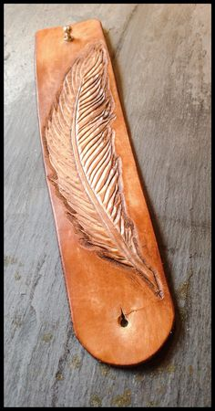 Tooled leather cuff with feather detail. https://www.etsy.com/shop/NuRedDesigns #tooled #leather #painted #dyed #brass #cuff