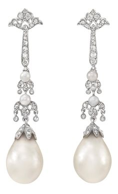 A Pair of Belle Epoque Platinum, Diamond and Natural Pearl Pendant-Earrings. circa 1905