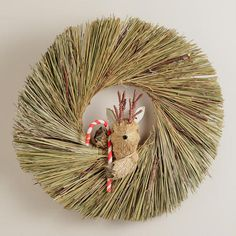 One of my favorite discoveries at WorldMarket.com: Reindeer with Candy Cane Wreath