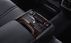2015 Kia K900 - Rear-seat armrest controls: control climate, seat heating, and more.