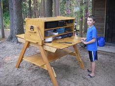 Chuck Box - camp kitchen with removable legs and bottom shelf. Set up without tools.
