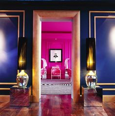 Making an Entrance: with gold mouldings on purple walls. And  over-scaled table lamps on mirror cubes.  Interior Designer: Philip Treacy.
