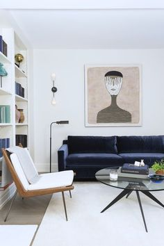 Navy velvet sofa, modern chairs, modern and minimalist home decor living room…
