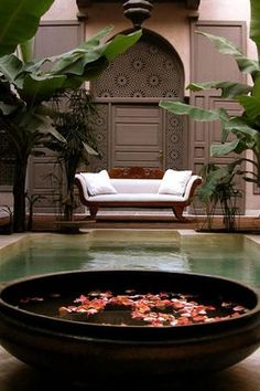 Open pool in a Moroccan Riad and some sprinkled rose petals. #Moroccan #Courtyard.