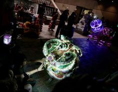 Happening now in front of the #crowcollection. Don't miss the glow in the dark lion dance! #DallasAurora #CrowAfterDark