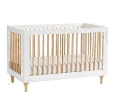 The Babyletto® Lolly Convertible Crib is a stylish space-saving solution for any modern nursery. With thought-out details like natural spindles and feet and a sturdy pinewood frame, this sleek crib is perfect for the smallest of spaces.