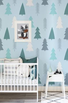 Transform your nursery spaces with our mountain forest wallpapers. Pastel mint trees are set against a calming blue to give you an ultramodern yet comfortable nursery room.