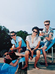 The Vamps <<< All of them are sitting normally... and then there's Con.