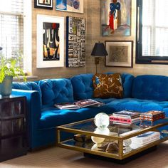 """ blue couches - like this amazing @milesredd decorated family room. (Photo by Roland Bello)"""