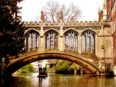 The Bridge of Sighs     in Cambridge, England  was built as a stone-covered bridge,  in the European way.  It is a part of St John's College of Cambridge University to this day. Designed by Henry Hutchinson, it was built in 1831 to cross the River Cam.