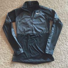 Nike Pro Women's slim fit Sz M - very flattering! Nike Pro slim fitting size medium long sleeve gray and black zip up shirt. Gently used condition. Nike Tops Sweatshirts & Hoodies