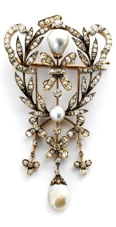 A Belle Epoque gold, diamond and natural pearl pendant, about 1900. 9.2 x 4.6cm.