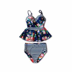**This suit is on Pre-Order** **Shipping Date: 2/20** Floral + Stripes = Dream Team! This peplum style tankini is sure to be your new favorite swimsuit. It's flattering, comfortable, high-quality, and