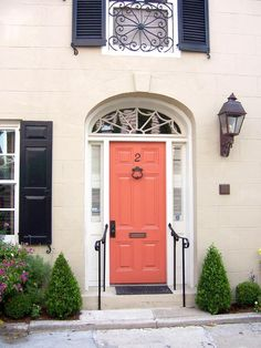 Popular colors to paint an entry door : Coral or salmon color - they say is best with neutral-colored home