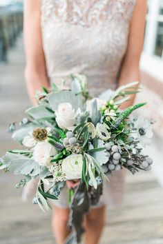 dusty miller + anemone bouquet, photo by Becky Williamson Photography http://ruffledblog.com/nautical-romance-wedding-ideas-in-charleston #weddingbouquet #flowers #bouquets