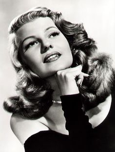 Rita Hayworth - What did she do to get her curls to behave like that?