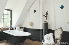 Black clawfoot tub in this black and white bathroom by designers Axel and May Vervoordt | Veranda.com