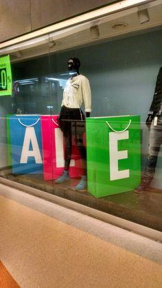 "Retail window display; ""BAGS on SALE"""