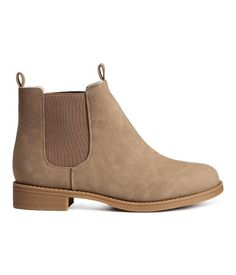 Chelsea boots in imitation leather with elasticated gores in the sides and rubber soles.