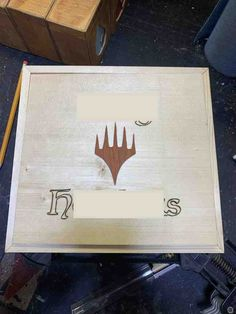 The accents added to a Magic The Gathering Box that will carry 6 deck boxes inside. Custom wood-burned name (mostly blocked out for privacy) and an accent MTG symbol carved from padauk. Wooden Decks, Box With Lid, Wood Glue, Magic The Gathering, Mtg, Custom Wood, Give It To Me, Boxes, Carving
