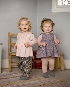 Wheat's fall 2014 collection features clothing cut for comfort, understated in color, with pops of bright red and saturated green to break up the neutral tones. Here, delicate prints and innocent shapes for toddlers. www.wheatusa.com (designer preview)