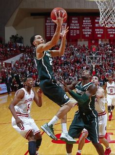 Travis Trice shoots the ball against the Indiana Hoosiers at Assembly Hall on January 4, 2014 in Bloomington, Indiana. Michigan State defeated Indiana 73-56. (Photo by Michael Hickey/Getty Images)