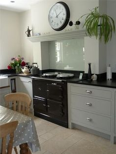 This is how to incorporate an aga into a modern kitchen design Kitchen Mantle, Aga Kitchen, Kitchen Chimney, Farmhouse Kitchen Cabinets, Cottage Kitchens, Kitchen Paint, Kitchen Living, Home Kitchens, Kitchen Decor