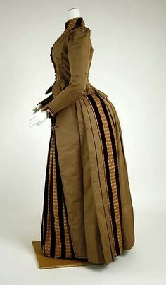 Day dress c.1886 from the Met Museum. The silk with velvet stripes, the tiny piping (on its way out in the 1880s), and the cut of the bodice front.