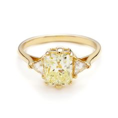 "Brides.com: 36 Yellow Gold Engagement Rings for Every Type of Bride. ""Bea"" 1.70 carat light yellow color radiant cut diamond center 1.98ctw set in 14kt yellow gold"