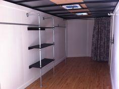 Cute mobile boutique interior w/ galvanized pipe shelves.