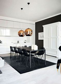 The lamps absolutely define this kitchen space.