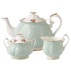 3-piece bone china tea set. Includes a teapot, sugar bowl, and creamer with polka-dot motifs, floral accents, and gold trim.      Pro...