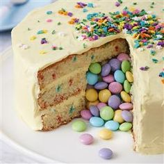 M&M's® Surprise Easter Cake is a sweet Easter surprise for your guests. After baking your 3 cake layers, cut a 3-inch circle in the center of 2 cake layers. Layer those 2 cakes and frosting then fill center hole with M&M's! Top with the third cake layer and frost the sides and top. Wait til your guests cut into the cake!