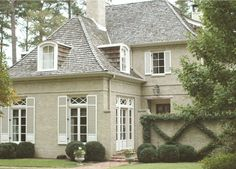 French perfection from Birmingham based Carraway & Associates Architects.  I love the combination of the limed brick, the cedar shake roof, and the French details.