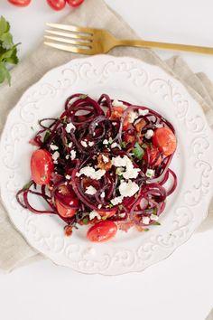 Beet Noodles with Tomatoes, Feta and Bacon    http://mybeautywellnessshop.com/    #Gwendolyn #kitchentips #bestkitchentips #beauty #wellness #healthyliving #amazon #veggettini #vegetablerecipe #vegetabletips #veggietips #saladrecipes #spiralslicer #vegetablespiralslicer #vegetablespiralcutter #veggieslicer #bestkitchenaidtool #kitchenaidtool #ceramicpeeler #pasta #spaghetti #paleo #paleodiet #healthyliving #healthyeating #vegetable #squash #zucchini #carrot #cucumber #pastalovers