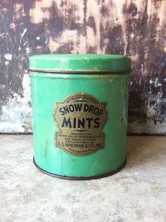 Great vintage advertising tin display piece! Beautiful minty green color and super deco era label. These mints were made by Whitman & Co.