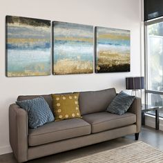 Add the beauty of the ocean to any space with the 'Rising 'Tide' textured canvas print. This piece features an abstract image of the ocean in a blue and brown finish. Each panel measures 24 inches high x 24 inches wide wide x 1.5 inches deep.