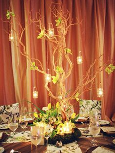 """Unexpected Centerpiece Idea: Candles Hanging From Branches Tea lights strung from manzanita branches capture a romantic """"enchanted forest"""" vibe."""