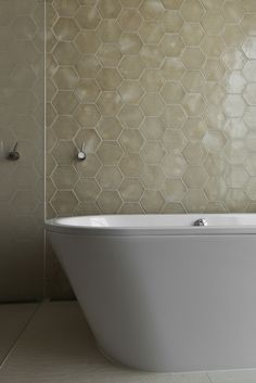 honeycomb hexagon tile design in a modern bathroom//