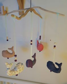 DIY Baby mobile. Whales, drive wood, pearls.   A co-operation with my friend, my husband and myself. Turned out pretty cute.