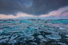 Ice Flow - Sunrise at the Jökulsárlón Glacier Lagoon in Iceland. Bow Fiddle Rock near Portknockie, Moray, Scotland.