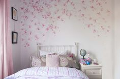 A beautiful cherry blossom tree sweeps across the wall of a little girl's bedroom. Soft, subtle layers of pink blossoms create depth, finished off with fine metallic and pearlescent details. This unique design has been hand-painted using a highly-skilled technique, referred to as 'unconscious' painting. Each blossom is painted with artistic spontaneity, creating an organic composition. This ancient art technique was taught to Diane by painting masters during a trip to China. The colour...