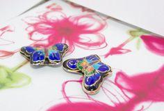 Enamel butterfly beads blue / black. 2 beads