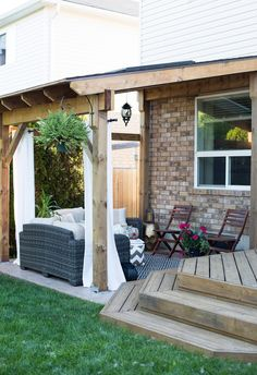 """How to Build a Covered Patio // Take the indoors outside by building a large covered patio. This step-by-step post will show you how to build a """"lean-to"""" style patio cover just in time for summer."""