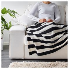Black and white throw blanket for bold, graphic touch. Would get one maybe 2 of these.