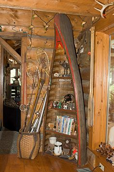a canoe cut in half and make it into a bookcase in the lake/creek home