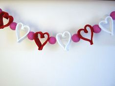 Betz White's Felt Heart Garland.  I would have to get Abigail to make me a lot of needle felted balls for this one.  Haha.