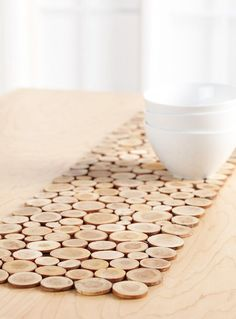 Use mini wood slices and a piece of felt to DIY this table runner.
