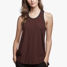 Contrast ringer tank. Bound crew neckline and armholes in contrast color. Racer back detail. Coverstitched bottom hem. Intended a-line fit. The textured feel of this cotton/linen blend elevates this easy fit top and accentuates its elegant drape. YH has great recovery for a continuous fit when worn. The contrast binding adds a novel, 70's twist. Same body as our classic WUC3070 Crepe Jersey A-Line Tank. Additional Information:• 70% Cotton 30% Linen• Fabric: YH• Fabric from ...